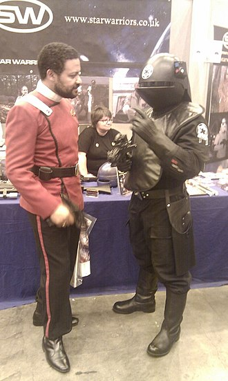 Comparison of Star Trek and Star Wars - A fan of Star Trek dressed in Starfleet uniform (left) and a fan of Star Wars dressed in Imperial Death Star gunner uniform (right) at Comic-Con 2010