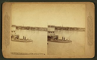 Steamboats of the Colorado River - Cocopah II at Yuma, Arizona. A stereoscopic picture of the Cocopah, the second stern-wheel steamboat of that name running on the Colorado River for the Colorado Steam Navigation Company between 1867 and 1879.  This photo was taken between 1877 and 1879, because the Southern Pacific railroad bridge built across the Colorado River in 1877 can be seen in the background.  The railroad took away the freight business making the Cocopah obsolete and it was retired in 1879 and dismantled in 1881.