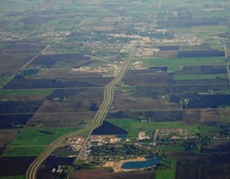Rural Municipality of Hanover - Steinbach (upper) and Blumenort (lower) as seen from the air.