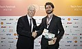 Stephane Dion congratulating Benjamin Britton at the Berlin Energy Transition Dialogue - 2018 (26672264887).jpg