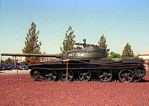 T-62 - Side view of a T-62. The tank in the picture has either damaged or disassembled torsion bars and its hull lies on the ground.