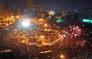 Top: Celebrations in Tahrir Square after the announcement of Hosni Mubarak's resignation; Bottom: Protests in Tahrir Square against President Morsi on 27 November 2012.