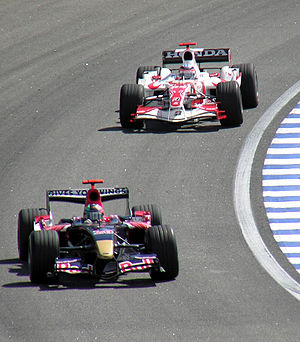 Super Aguri SA06 - Sato chasing Vitantonio Liuzzi at the 2006 Brazilian Grand Prix, the last race of the season. At the race, he recorded best result of the season for the car and team with 10th position.
