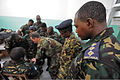 Tanzania People's Defense Force Capt. Clement Selengia Swai, right, watches U.S. Navy Petty Officer 1st Class Will Brogdon as he mentors medical team members during a tactical combat casualty care course as part 120306-N-RB546-072.jpg