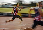 Tech. Sgt. Benjamin Seekell, of Team U.S., sprints during the male 100-meter track finals at the ESPN Wide World of Sports Complex (26957337226).jpg