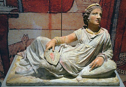 Terracotta sarcophagus in shape of an etruscan woman