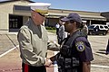 The 35th Commandant of the Marine Corps, Gen. James F. Amos, left, shakes hands with an Air Force Security Force officer after visiting the Marine Fighter Attack Training Squadron 501 (VMFAT-501) at Eglin Air 130504-M-LU710-233.jpg
