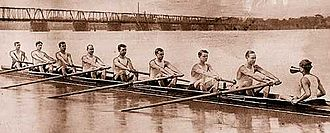 Detroit Boat Club - The Detroit Boat Club was quick to adopt the sleek new racing sculls developed around the turn of the century. This 1904 team helped keep the club a major force in rowing. The old Belle Isle Bridge can be seen in the background.