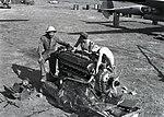 The Mechanics Working on an Engine (BOND 0145).jpeg