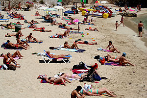 People sunbathing on beach, Mallorca. Original...