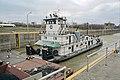 Towboat Enid Dibert departing main lock at McAlpine Locks, 1999, Ohio River mile 607 (99c025).jpg