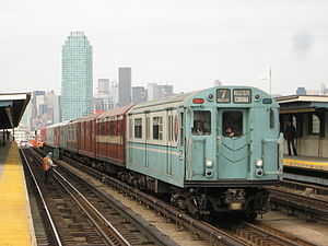R33 World's Fair (New York City Subway car) - R33WF 9306, in its original colors, leads the Train of Many Colors through 40 Street–Lowery St on a <7> express run to Mets–Willets Point.