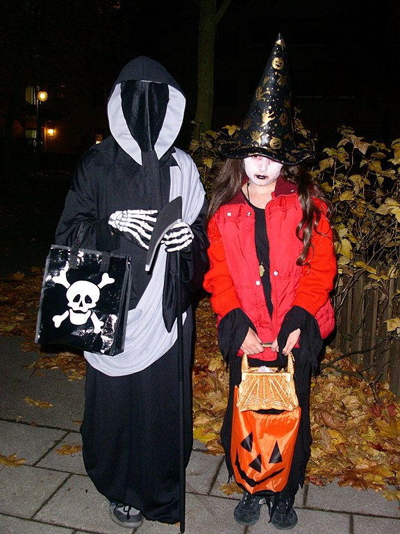 Kids dressed up as grim reaper and which for halloween