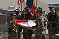 U.S. Army Col. Diana Holland, left, and Command Sgt. Maj. Jon Etter, the command team for the 130th Engineer Brigade, case the brigade colors during a transfer of authority ceremony at Bagram Airfield, Parwan 131002-A-SX798-074.jpg