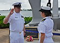 U.S. Navy Ensign Katherine A. Rentz, right, re-enlists Chief Air Traffic Controller Gary W. Sartain Feb. 21, 2012, at the USS Arizona Memorial visitors center at Joint Base Pearl Harbor-Hickam, Hawaii 120221-N-ZP663-020.jpg