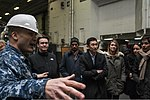 U.S. Navy Lt. Cmdr. James Stockman, left, a public affairs officer assigned to the aircraft carrier USS George Washington (CVN 73), explains hangar bay operations to members of the Council on Foreign Relations 140310-N-IV489-067.jpg