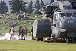 U.S. Sailors with Helicopter Mine Countermeasures Squadron (HM) 15, Detachment 2 help Pakistani soldiers load relief supplies onto a U.S. Navy MH-53E Sea Dragon helicopter during humanitarian relief efforts 100821-M-ZG155-811.jpg