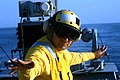 US Navy 020909-N-8848T-029 Sailor signals SH-60 helicopter go for launch.jpg