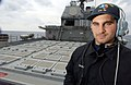 US Navy 030303-N-3235P-507 Seaman Raymond L. Guadio, assigned to the ship's deck department, stands a lookout watch.jpg