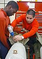 US Navy 030327-N-1328C-505 Airman Recruit Jose Martinez (right) assembles a bomb aboard USS Theodore Roosevelt (CVN 71).jpg