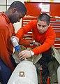 US Navy 030327-N-1328C-505 Airman Recruit Jose Martinez (right) assembles a bomb aboard USS Theodore Roosevelt (CVN 71).jpg