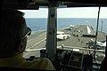 US Navy 030327-N-4308O-033 The Air Boss observes flight operations from primary flight deck control.jpg
