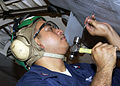 US Navy 030708-N-0174W-501 Aviation Structural Mechanic 2nd Class Jeffrey A. Sims from New Jersey, N.J. removes working rivets from the wing of a P-3 Orion aircraft.jpg