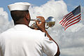 US Navy 030830-N-3228G-006 Musician 3rd Class Anthony Class, assigned to Pacific Fleet Band, performs taps while facing the National Ensign during a burial ceremony on board the USS Utah Memorial, for Darrell Allen, a Pearl Har.jpg