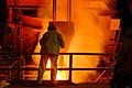 US Navy 030910-N-7542D-240 A worker from the Amite Foundry supervises the pouring of molten steel recycled from the World Trade Center into a ladle.jpg