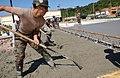 US Navy 031017-N-9712C-003 Construction Electrician Constructionman John Tingler evens out cement.jpg