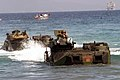 US Navy 040223-M-4806Y-038 Amphibious Assault Vehicles (AAV) arrive on the Philippine shore from the amphibious transport dock ship USS Fort McHenry (LSD 43).jpg