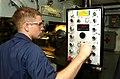 US Navy 040709-N-7232R-012 Fireman Mathew Lucas controls cuts being made to a spur gear on a milling machine in the machine shop aboard USS John C. Stennis (CVN 74).jpg