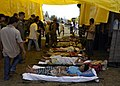 US Navy 050105-N-5376G-008 Tsunami victims receive medical attention from U.S. Navy Medical personnel and aid workers at Sultan Iskandar Muda Air Force Base in Banda Aceh, Indonesia.jpg
