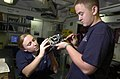 US Navy 050814-N-4843B-053 Aviation Electrician's Mate Airman Victoria Benson, and Aviation Electrician's Mate 3rd Class Brian McCraven, test the internal wiring of a control stick adapter for an F-A-18E Super Hornet.jpg