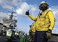 US Navy 051120-N-9742R-003 Aviation Boatswain's Mate 1st Class Wonderful Parker, signals to the catapult officer that a jet is ready to launch from the flight deck aboard the nuclear-powered aircraft carrier USS Enterprise (CVN.jpg