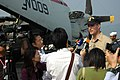 US Navy 051125-N-6106R-034 Public Affairs Officer for USS Kitty Hawk (CV 63), Lt. Cmdr. Terry Dudley, speaks with a group of media representatives on the flight deck during a port visit to Hong Kong.jpg