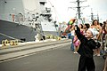US Navy 070407-N-4856G-034 A little boy waves to his father as families of Sailors stationed aboard guided missile destroyer USS Russell (DDG 59) wait patiently as the ship returns to Naval Station Pearl Harbor.jpg