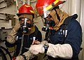 US Navy 070824-N-5822P-013 Machinery Repairman Kenneth R. Williams, left, turns over scene leader responsibilities to Aviation Structural Mechanic 2nd Class Shadrack S. Goad during a fire drill aboard USS Bonhomme Richard (LHD.jpg