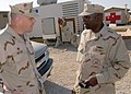 US Navy 071114-N-0553R-001 Capt. Robert A. McLean, commander, Naval Construction Regiment (NCR) 21, talks with Senior Chief Storekeeper Melvin Lawrence, attached to Naval Mobile Construction Battalion (NMCB) 1.jpg