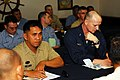 US Navy 080220-N-0237L-077 Philippine navy officer, Lt. Tirso L. Chavez and, U.S. Navy Chief Warrant Officer Doyle Purdy attend a planning meeting to ensure both navies are able to communicate during the bilateral exercise Bali.jpg