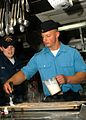 US Navy 080612-N-5283B-016 Culinary Specialist Seaman Mindy Best watches Culinary Specialist 3rd Class Andree Bode, of the German frigate FGS Bayern (F 217), ice a sugar cake in the galley of the guided-missile destroyer USS Co.jpg