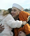 US Navy 090110-N-8467N-005 Gunners's Mate 1st Class Dale Horkey embraces his children after the fast-attack submarine USS Alexandria (SSN 757) pulls into Submarine Base New London.jpg