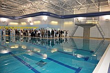 Guests tour the new LT Michael Murphy Combat Training Pool during a dedication ceremony at Officer Training Command, Newport. The pool will be used by officer candidates and students at Officer Training Command Newport for swim qualifications.