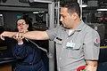 US Navy 090714-A-1839I-038 Hospital Corpsman 1st Class Elizabeth Gracie demonstrates how to apply an arm splint during a first aid class given to Brazilian Navy sailors aboard the amphibious dock landing ship USS Oak Hill (LSD.jpg