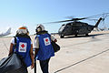 US Navy 100122-N-7456N-077 American Red Cross volunteers board an MH-53E Sea Dragon helicopter bound for Haiti at Naval Station Guantanamo Bay airfield.jpg