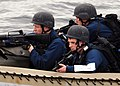 US Navy 100415-N-1559J-027 Members of the visit, board, search and seizure team of the guided-missile destroyer USS Laboon (DDG 58) conduct a maritime interdiction operation exercise in a rigid-hull inflatable boat during exerc.jpg
