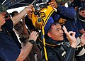 US Navy 100515-N-7643B-181 U.S. Navy Divers take the MK-21 diving helmet off Royal Thai Navy diver Petty Officer 1st Class Sarawut after completing a Cooperation Afloat Readiness and Training (CARAT) Thailand 2010 training dive.jpg