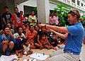 US Navy 100623-N-4044H-056 Georgia Ferris, a member of Latter-day Saint Charities, plays a game with children and adults during a community service event at the Enfants du Cambodge orphanage in Sihanoukville, Cambodia.jpg