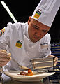 US Navy 100805-N-3069F-001 Chief Culinary Specialist Brandon Parry, assigned to Commander, Naval Air Forces in San Diego, plates his main entree during the American Culinary Federation's Chef of the Year competition.jpg