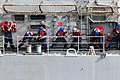 US Navy 110728-N-SB672-323 Sailors assigned to the guided-missile cruiser USS Chancellorsville (CG 62) heave lines to connect a fuel probe during a.jpg
